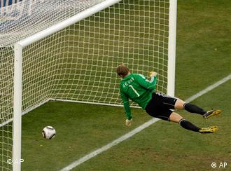 Germany goalkeeper Manuel Neuer looks at the ball that hit the bar to bounce over the line