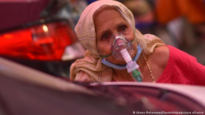 A woman suffering from breathing problems receives free oxygen support at a gurdwara