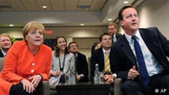 Prime Minister David Cameron, right, and Chancellor Angela Merkel watch the World Cup
