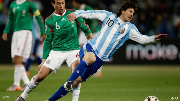 Argentina's Lionel Messi is tackled