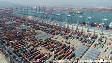 ©/MAXPPP - QINGDAO, CHINA - OCTOBER 08: Aerial view of containers sitting stacked at Asia's first fully automated container terminal of Qingdao Port on October 8, 2020 in Qingdao, Shandong Province of China. (Photo by Zhang Jingang/VCG)