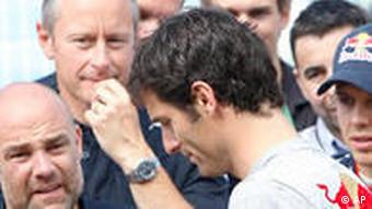 Driver Mark Webber amongst his Red Bull team staff at the European Grand Prix in Valencia