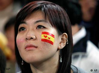 A Chinese fan of Spain's Rafael Nadal wears face paint with the colors of the Spanish flag and Rafa's name during his match with Russia's Marat Safin in the quarter finals of the China Open tennis tournament in Beijing, China, Friday, Oct. 9, 2009. Nadal won 6-3, 6-1. (AP Photo/Elizabeth Dalziel)