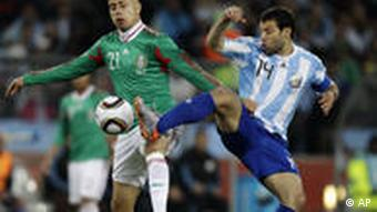 Mexico's Adolfo Bautista, competes for the ball with Argentina's Javier Mascherano