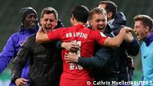 Soccer Football - DFB Cup - Semi Final - Werder Bremen v RB Leipzig - Weser-Stadion, Bremen, Germany - April 30, 2021 RB Leipzig coach Julian Nagelsmann celebrates winning the match with Hwang Hee-chan Pool via REUTERS/Cathrin Mueller DFB regulations prohibit any use of photographs as image sequences and or quasi-video.