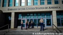 US Marines stand outside the Embassy of the United State of America in Havana, on February 21, 2018. / AFP PHOTO / ADALBERTO ROQUE (Photo credit should read ADALBERTO ROQUE/AFP via Getty Images)
