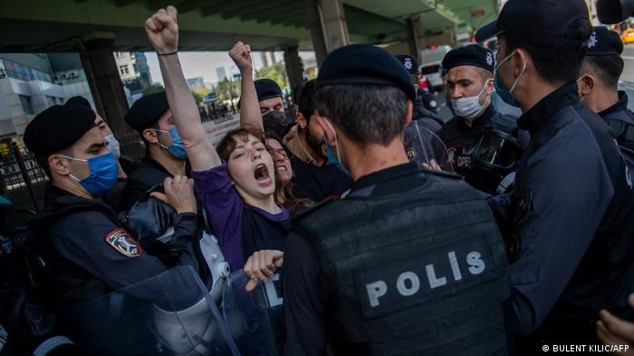Turkish police detain demonstrators during a May Day rally in Istanbul