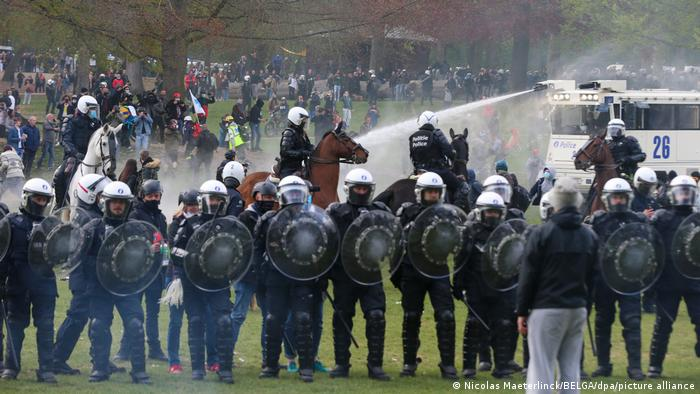 Police and protesters clash during a second party protest at a park in Brussels, Belgium