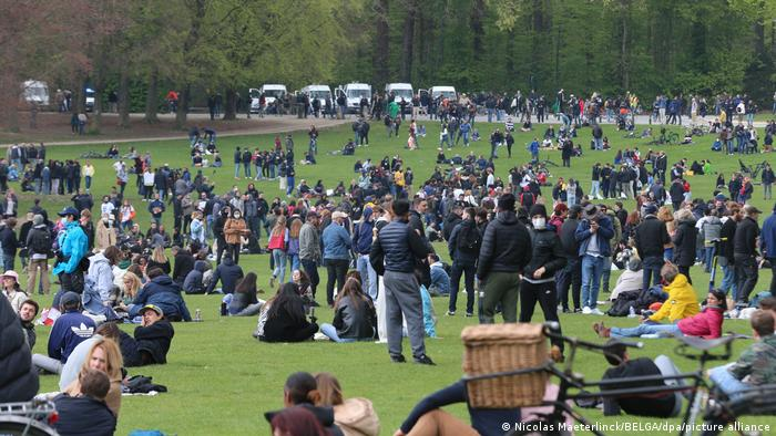 Scores of people gather for a party at a park in Brussels to protest lockdown restrictions