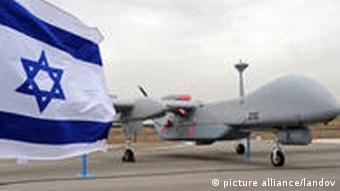 An Israeli made unmanned aerial vehicle, the Heron TP, is displayed at its induction ceremony