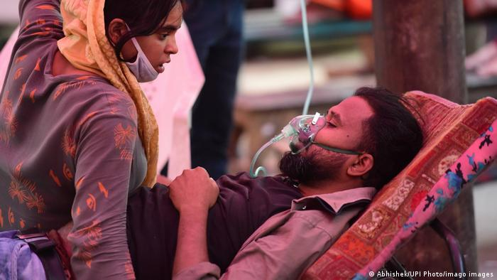 A COVID-19 patient receives free oxygen, provided by a gurdwara in Uttar Pradesh
