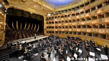 """Musicians and chorus of the Fenice Opera theatre perform the """"Verdi e la Fenice"""" ( Verdi and the Fenice ) to mark the reopening of the Fenice Opera theater in Venice on April 26, 2021 as bars, restaurants, cinemas and concert halls partially reopen across Italy in a boost for coronavirus-hit businesses, as parliament debates the government's 220-billion-euro ($266-billion) EU-funded recovery plan. - After months of stop-start restrictions imposed to manage its second and third waves of Covid-19, Italy hopes this latest easing will mark the start of something like a normal summer. (Photo by ANDREA PATTARO / AFP)"""