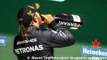 Lewis Hamilton celebrates his win in Portugal