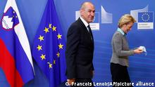 Slovenian Prime Minister Janez Jansa, left, walks with European Commission President Ursula von der Leyen prior to a meeting at EU headquarters in Brussels, Thursday, July 9, 2020. (Francois Lenoir, Pool Photo via AP)
