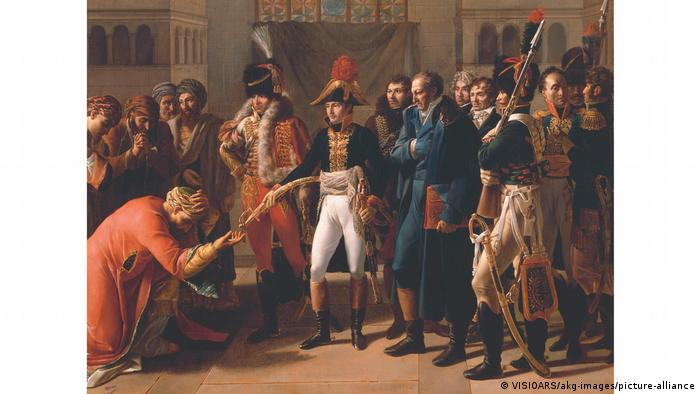 A painting showing Napoleon handing a saber to a military leader in Alexandria, who is bowing in front of him.