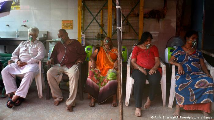 COVID-19 patients receive oxygen outside a Gurdwara, a Sikh house of worship, in New Delhi