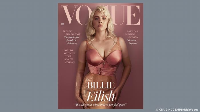 Billie Eilish on the June cover of British Vogue in 1950s style: wearing a pink corset and with bleach-blonde hair.