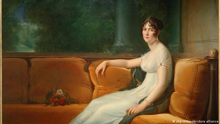 Josephine de Beauharnais shown seated on a beige sofa and wearing a white dress.