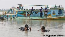 MADARIPUR, BANGLADESH - MAY 03, 2021: Rescue workers searching in the river after a speedboat collided with a vessel transporting sand in the Padma River in Madaripur district in Bangladesh on May 03, 2021. At least 26 people died when a speedboat packed with passengers collided with a sand-laden vessel on the Padma River in Bangladesh. Stringer / Anadolu Agency