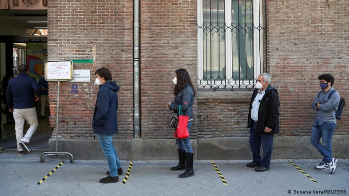 Voters waiting outside a polling station in Madrid