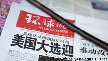 A copy of the Chinese state-run Global Times newspaper with a headline about the U.S. presidential elections is displayed at a newsstand in Beijing, Tuesday, Nov. 3, 2020. The world is watching as millions of Americans cast their ballots for the next president on Tuesday. (AP Photo/Mark Schiefelbein)