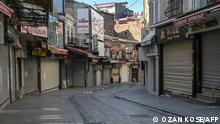 Closed shops are pictured in a deserted street in Istanbul on April 30, 2021, during a new lockdown aimed at fighting a surging third wave of Covid-19 infections. - Turkey will enter a full closure from April 29 to May 17, that requires people to stay indoors without a valid reason and sees all non-essential businesses closed. The nation of 84 million has seen daily Covid-19 death tolls rise to around 350 -- higher than during two previous spikes last year. (Photo by Ozan KOSE / AFP)