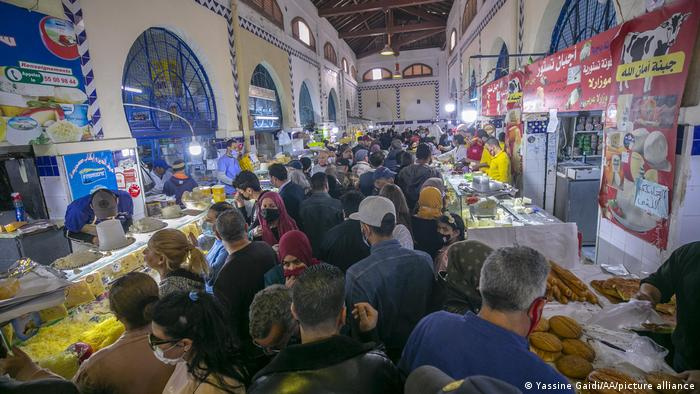 People go for shopping on the first day of Ramadan amid Covid-19 pandemic at Central Bazaar in Tunis.