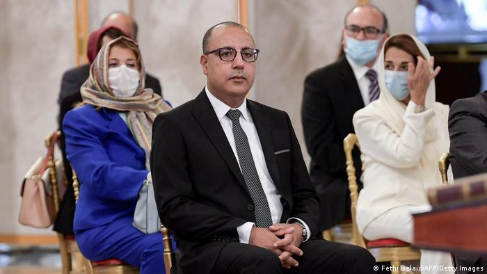 Tunisia's Prime Minister Hichem Mechichi attends the new government swearing-in ceremony with his ministers.