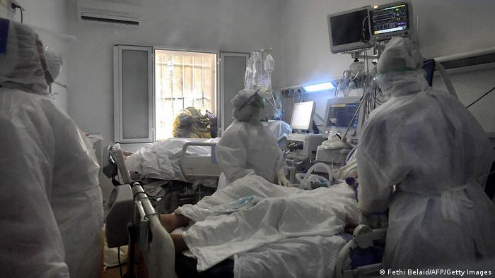 Tunisian medical staff attend coronavirus patients at the intensive care unit of the Ariana Abderrahmen Mami hospital.