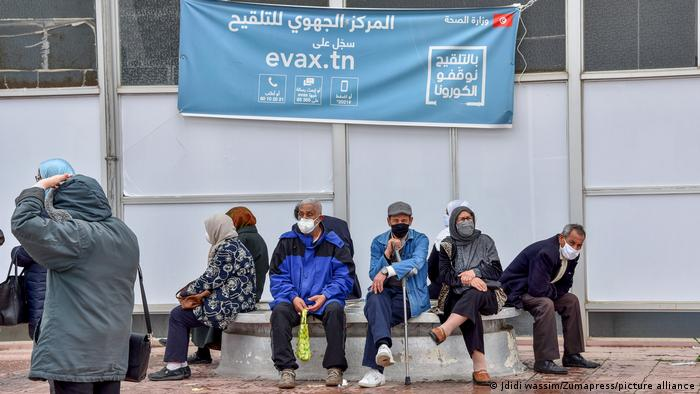 Elderly people in Tunis wearing facemasks as a preventive measure against the spread of covid-19 wait to get vaccinated against COVID-19.