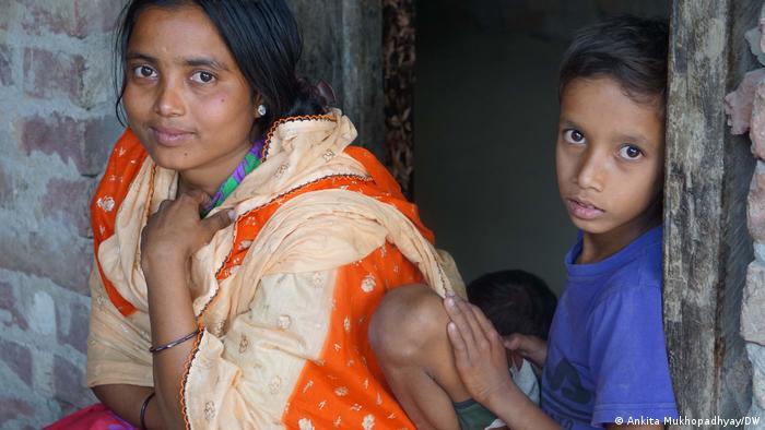 Rimpa Bibi poses with her son