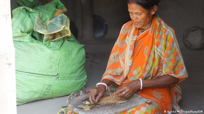A woman rolls cigarettes in West Bengal