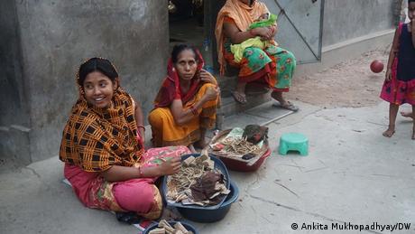 Women roll beedis in Lalgola village in West Bengal