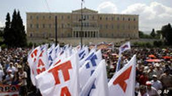 Strikers take part in a rally in front of the Greek Parliament