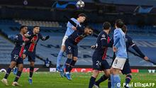 Manchester City's English defender John Stones (C) vies to header the ball with Paris Saint-Germain's Argentinian forward Mauro Icardi during the UEFA Champions League second leg semi-final football match between Manchester City and Paris Saint-Germain (PSG) at the Etihad Stadium in Manchester, north west England, on May 4, 2021. (Photo by Paul ELLIS / AFP)