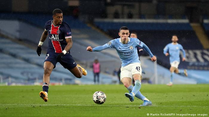 Phil Foden in action for Manchester City against PSG