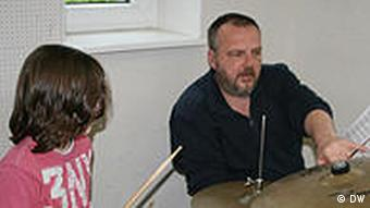 Percussion lesson showing pupil with teacher.
