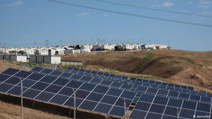 A solar panel park stands outside a refugee camp in Iraq