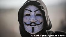 GAZA CITY, GAZA - AUGUST 17 : A Palestinian protester wearing anonymous V For Vendetta Guy Fawkes mask is seen on the 21st Friday of Great March of Return demonstration, near Israel-Gaza border at Al-Bureyc refugee camp, in Gaza City, Gaza on August 17, 2018. Hassan Jedi / Anadolu Agency