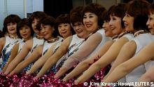 April 12, 2021*** Members of a senior cheer squad called Japan Pom Pom pose for commemorative photos before filming a dance routine for an online performance in Tokyo, Japan, April 12, 2021. Picture taken April 12, 2021. REUTERS/Kim Kyung-Hoon SEARCH KYUNG-HOON CHEER FOR THIS STORY. SEARCH WIDER IMAGE FOR ALL STORIES.
