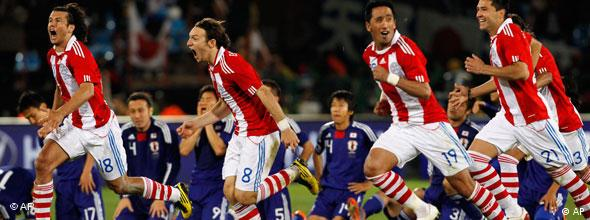 The Paraguay team celebrate after winning the penalty shoot-out