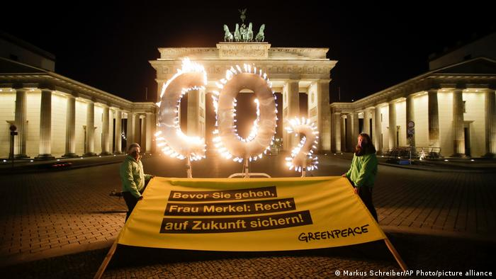 Greenpeace activists demonstrate in front of the Brandenburg Gate in Berlin, Germany