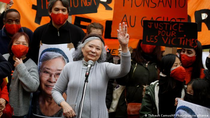 File photo: Tran To Nga waves as she delivers a speech during a gathering in support of people exposed to Agent Orange.