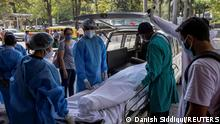 May 2, 2021*** Relatives of Karuna Vadhera, 74, who died while suffering from complications related to the coronavirus disease (COVID-19), stand by her body as it is moved out of the emergency room to be taken to a crematorium, at Holy Family Hospital in New Delhi, India, May 2, 2021. REUTERS/Danish Siddiqui SEARCH SIDDIQUI AGGARWAL FOR THIS STORY. SEARCH WIDER IMAGE FOR ALL STORIES