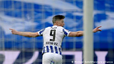Hertha Berlin's Krzysztof Piatek celebrates after scoring his side's opening goal against Freiburg
