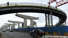 Motorists drive on Mombasa road, past ongoing construction site of the Nairobi Expressway, undertaken by the Chinese contractor China Road and Bridge Corporation (CRBC), in Nairobi on February 10, 2021. (Photo by Simon MAINA / AFP) (Photo by SIMON MAINA/AFP via Getty Images)