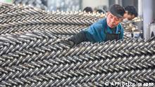 A worker sets up wheels at a factory in Hangzhou in China's eastern Zhejiang province on April 16, 2021. - - China OUT (Photo by STR / AFP) / China OUT (Photo by STR/AFP via Getty Images)
