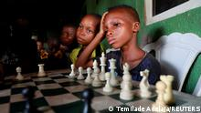 May 5, 2021*** Children play chess at a community palace in Makoko, Lagos, Nigeria May 5, 2021. Picture taken May 5, 2021. REUTERS/Temilade Adelaja TPX IMAGES OF THE DAY