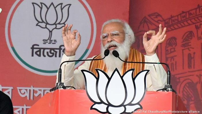 Indian Prime Minister Narendra Modi delivers a campaign speech on April 12,2021