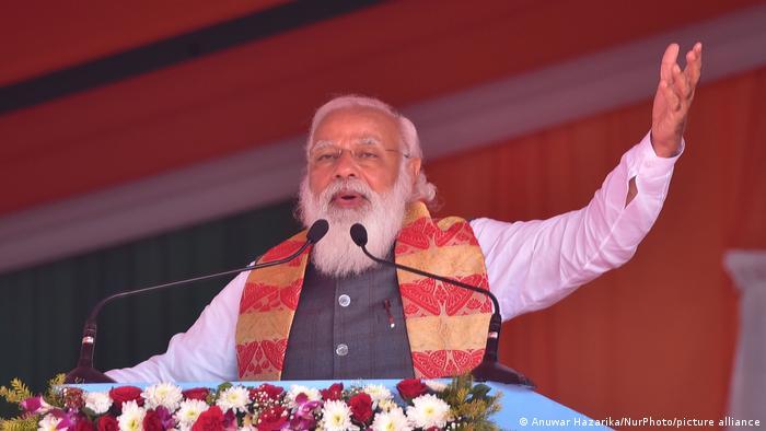 Indian PM Narendra Modi gestures during a speech